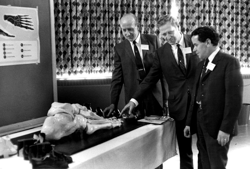 Bill Foster (centre) with managers Sam Weir (left) and Joe Kidd (right) at orthopedic surgeon's meeting circa 1967
